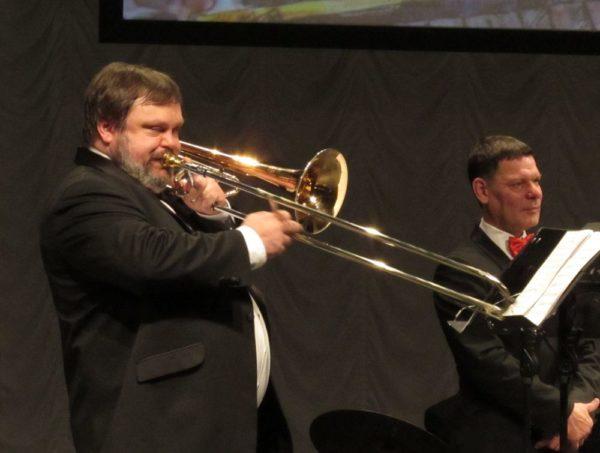 Загадки про музыкальные инструменты тромбон